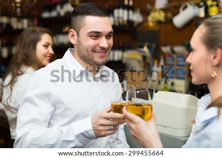 Small bar with female barista 35 years old and two clients at counter - stock photo