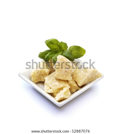 Small basket with  basil, and  parmesan on white background - stock photo