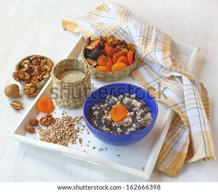 Small basket with wheat porridge which is cooking on Christmas Eve Kutya is a traditional food on Christmas Eve. - stock photo
