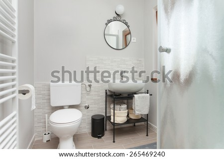 small bathroom with shower - stock photo