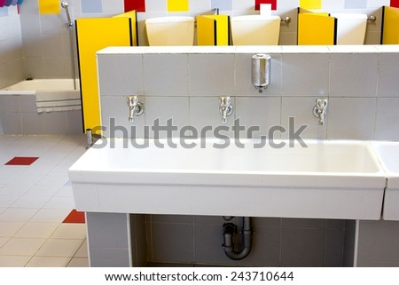 small bathrooms of a school for children with low ceramic sinks