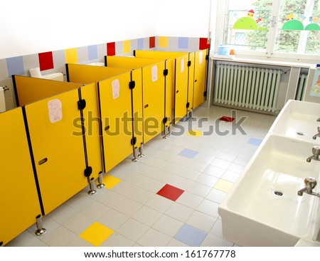 small bathrooms of children in a kindergarten  and very low sinks - stock photo