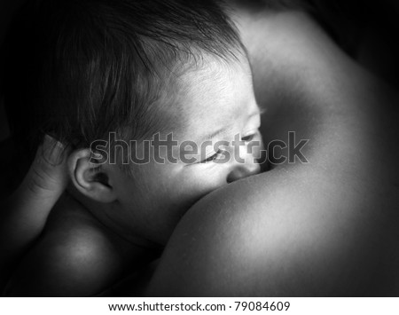 Small beautiful chaild on the mothers hands - stock photo