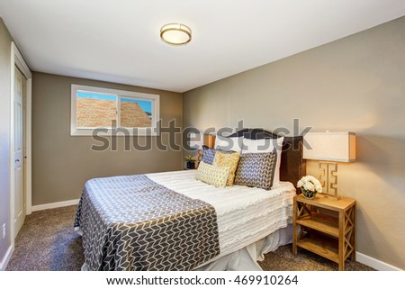 Small bedroom interior with gray walls and carpet floor. Northwest, USA