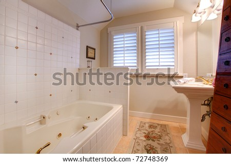 Small bedroom with large brown bed - stock photo