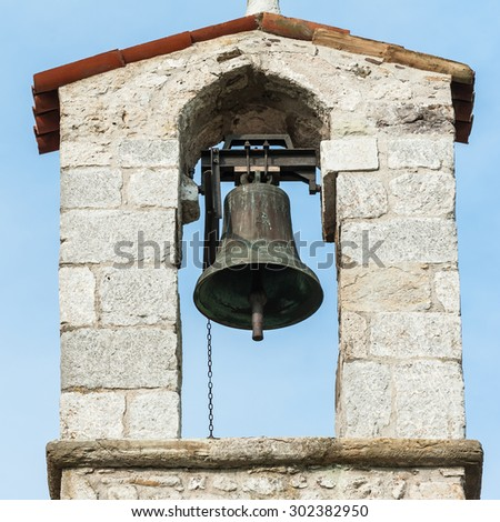 Small bell tower with a bell of a country church in the 13th century - stock photo