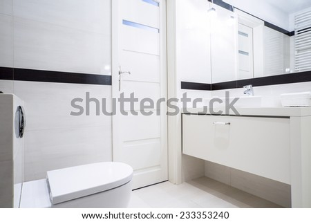 Small black and white bathroom with modern furnishings - stock photo