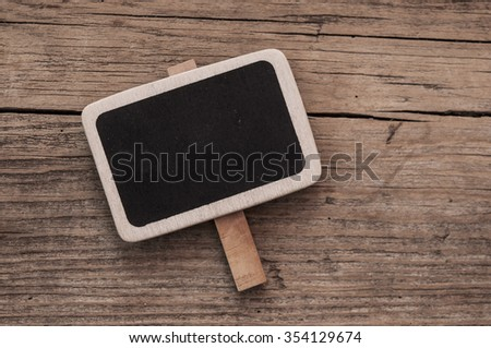 Small black chalkboard on wood background
