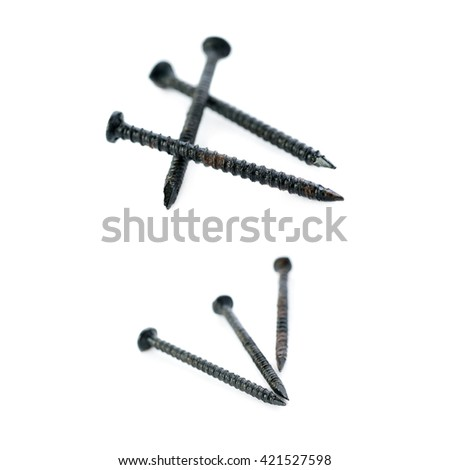 Small black Pail of Metal nails isolated over the white background - stock photo