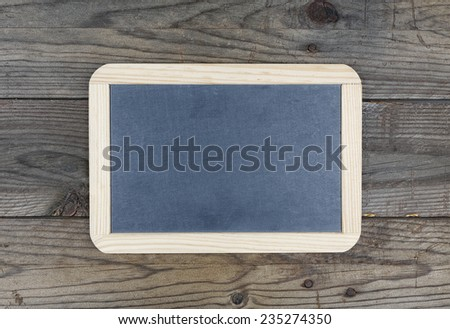 Small blackboard chalkboard on wooden texture background - stock photo