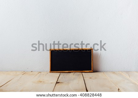 small blackboard on wooden floor