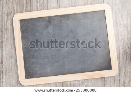 small blackboard on wooden plate - stock photo