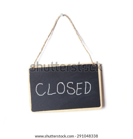 small blackboard sign with the word closed written on it in chalk               - stock photo