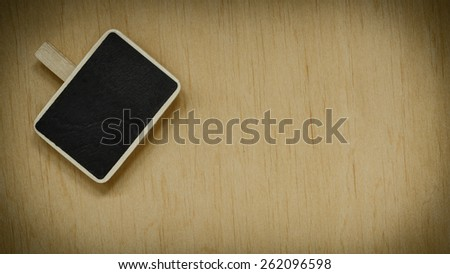 small blackboard slate chalk board clip with space for text menu on wooden surface, empty blank sign - stock photo