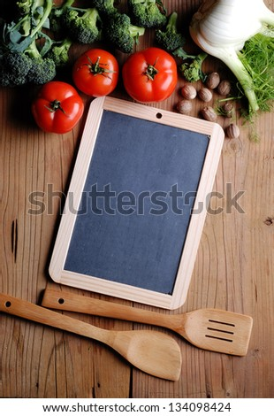 small blackboard with vegetables around