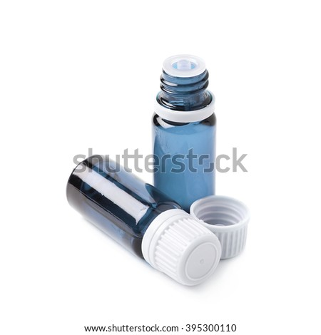 Small blue glass flask vial, composition isolated over the white background