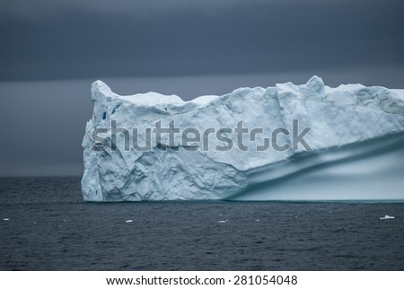 Small blue iceberg in Greenland Sound, southern Greenland - stock photo