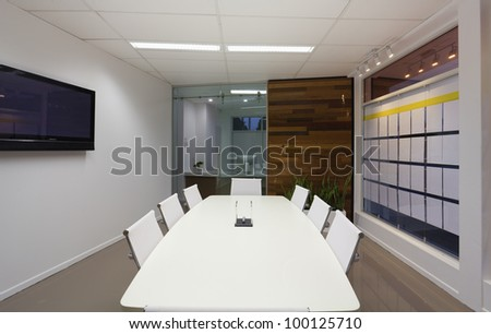 Small board room or meeting room in new office. - stock photo