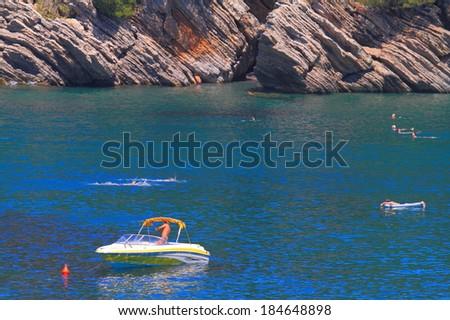 Small boat anchored on the Adriatic sea - stock photo