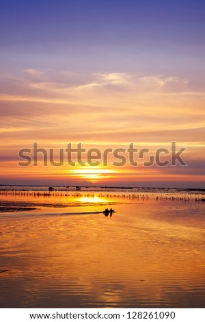small boat in sunset - stock photo