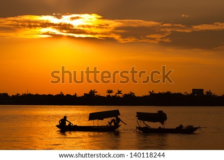 small boat of Vietnam transportation sales people across the river - stock photo