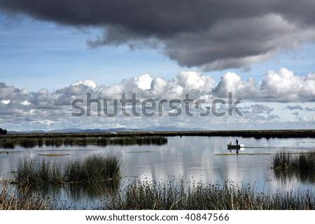 small boat on Lake Titacaca, Peru - stock photo