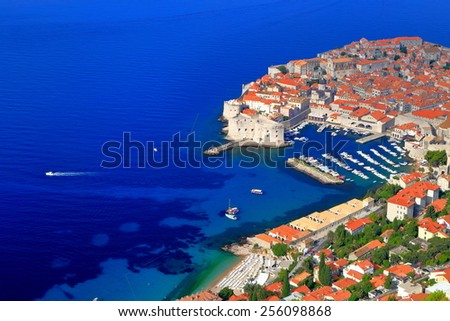 Small boat on the Adriatic sea leaving Dubrovnik old town, Croatia - stock photo