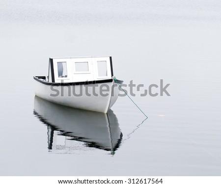 Small Boat Reflection - stock photo
