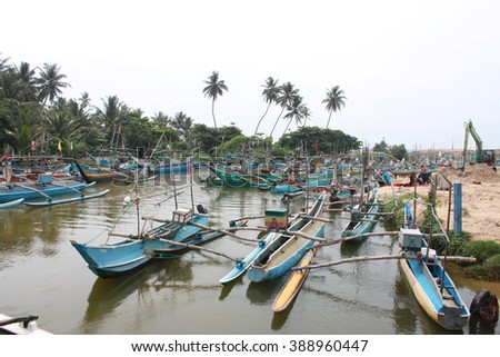 Small boats dock on the river, some where in Sri Lanka. Gondolas are the most popular boat in Sri Lanka. The local fisherman use for catching fish in the sea.