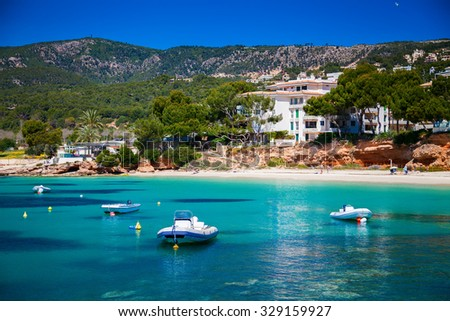 small boats in front of the beach in Portals Nous, Mallorca, Spain
