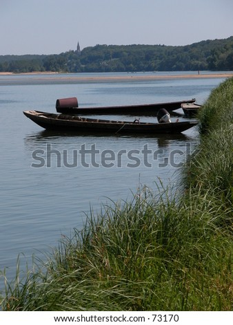 Small boats in the river Loire, France. - stock photo