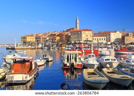 Small boats inside crowded harbor of an old Venetian town harbor, Rovinj, Croatia - stock photo