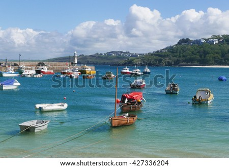 Small boats moored in harbour. St. Ives, Cornwall, England.
