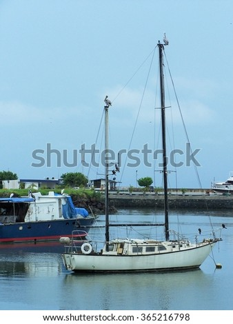 Small boats near the mouth of the Panama Canal on the Pacific Side - stock photo