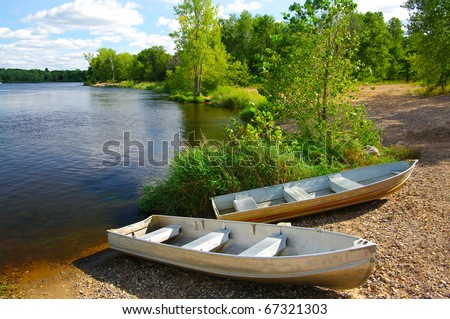 Small Boats on Shore: Small fishing boats wait on the shore of a Wisconsin lake.