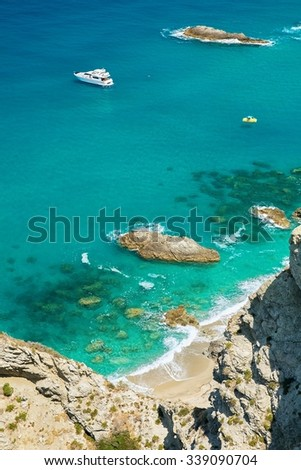 Small boats on the crystal clear sea  near the town of Tropea region Calabria - Italy - stock photo
