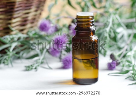 Small bottle of essential oil - stock photo