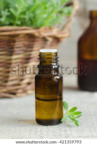 Small bottle of essential oil (herbal tincture)