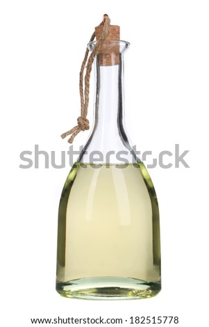 Small bottle of olive oil with cork stopper. Isolated on a white background. - stock photo