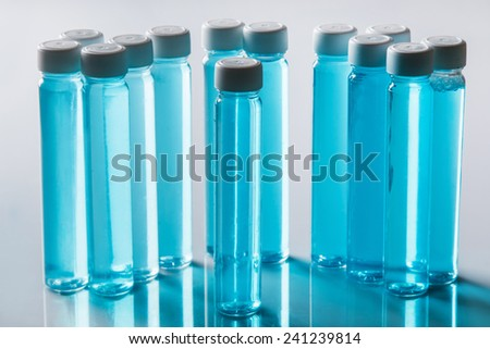 Small bottles with blue liquid