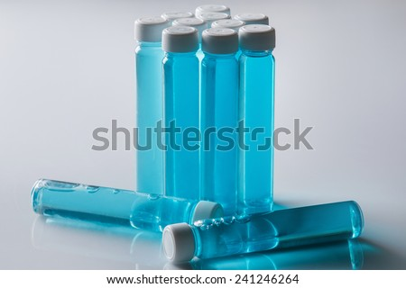Small bottles with blue liquid - stock photo