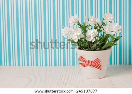 small bouquet of flowers on a colored background