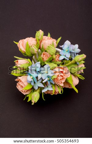 Small bouquet of flowers on dark background