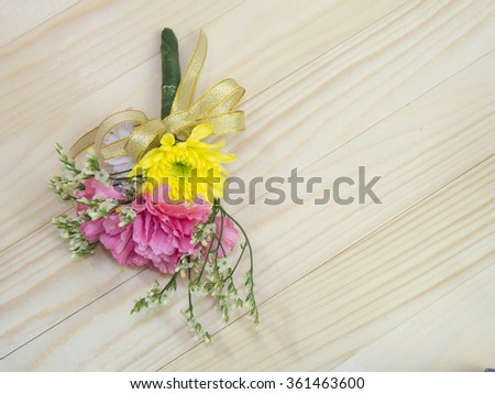 small bouquet on wooden background