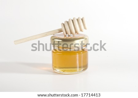 small bowl of honey with wood stick - stock photo