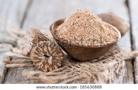 Small bowl with fresh grated Nutmeg Powder - stock photo