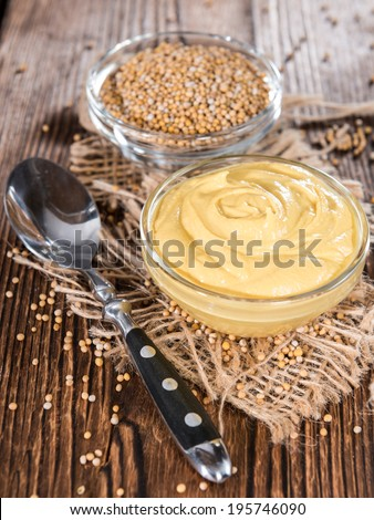 Small bowl with Mustard sauce (close-up shot) - stock photo