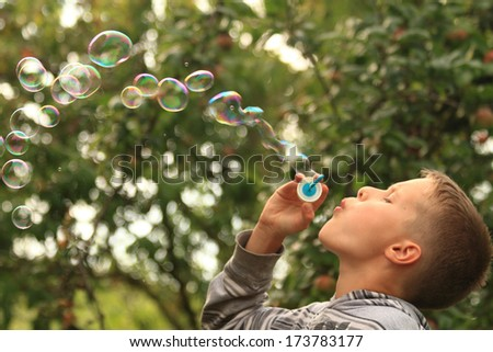 small boy and bubbles