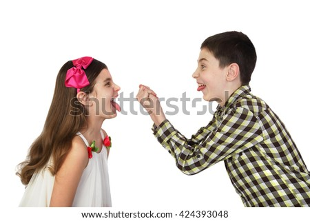 Small boy and girl tease one another show tongues and gesturing isolated on white background - stock photo