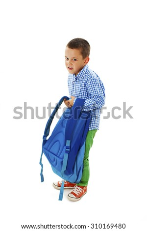 Small boy carrying heavy school bag. Isolated on white background - stock photo